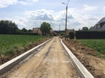 Afwerking Lange Veldstraat: kantstroken aangebracht. Het asfalt kan komen.