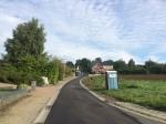 De Lostraat in Schepdaal kreeg een nieuwe slijtlaag waardoor de straat volledig in topstaat is